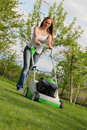 Girl mows the lawn Royalty Free Stock Photo
