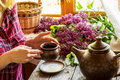 A girl with mug and lilac. Royalty Free Stock Photo