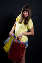 Girl with multi-colored packages Royalty Free Stock Photo
