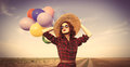 Girl with multicolored balloons Royalty Free Stock Photo