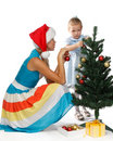 Girl with mum decorates a Christmas tree Royalty Free Stock Image