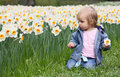 Girl and narcissus Royalty Free Stock Photo