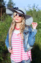 Girl on the nature in a hat Royalty Free Stock Photo