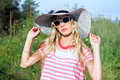 Girl on the nature in a hat sunbathing Royalty Free Stock Photo