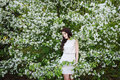 Girl near a bush of white flowers Royalty Free Stock Photo