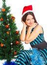 Girl near Christmas fir tree Royalty Free Stock Image
