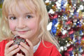 Girl near Christmas fir-tree Royalty Free Stock Photography