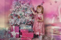 Girl near christmas fir tree with gifts Stock Photos