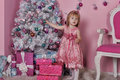 Girl near christmas fir tree with gifts Royalty Free Stock Image