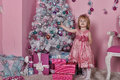 Girl near christmas fir tree with gifts Stock Images