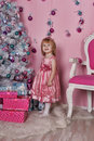 Girl near christmas fir tree with gifts Stock Photo