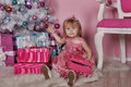 Girl near christmas fir tree with gifts Royalty Free Stock Photos