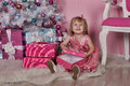 Girl near christmas fir tree with gifts Stock Image