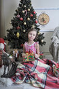 Girl near christmas fir tree little with gifts Royalty Free Stock Photo
