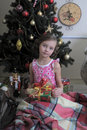 Girl near christmas fir tree little with gifts Royalty Free Stock Photography