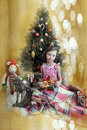 Girl near christmas fir tree little with gifts Royalty Free Stock Image