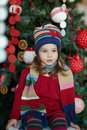 Girl near the christmas tree little in a celebratory dress Stock Photos