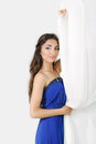 Girl near curtains posing in studio blue dress Stock Photos