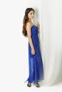 Girl near curtains posing in studio blue dress Stock Photo