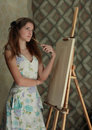 Girl near easel Royalty Free Stock Photo