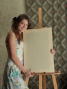 Girl near easel Royalty Free Stock Photography