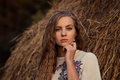 Girl near the hay model staying hill Stock Photography