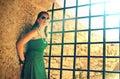 Girl near prison bars Royalty Free Stock Photo