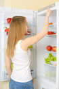 Girl near the refrigerator Stockfoto