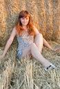 Girl near roll of hay. Stock Photos