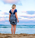 Girl near the sea rear view of sexy young woman standing on beach Stock Photo
