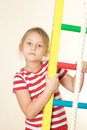 Girl near the sports equipment pretty little Royalty Free Stock Photo