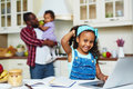Girl networking happy african american looking at camera while in the kitchen Royalty Free Stock Images