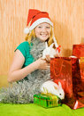 Girl in new year decoration with rabbits Royalty Free Stock Image