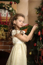 Girl next to a Christmas tree Royalty Free Stock Photography