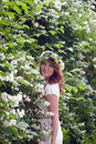 Girl next to a flowering tree beautiful near Stock Images