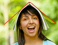 Girl with notebook on her head Stock Photo