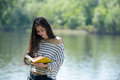 Girl with a notebook in park near the river Royalty Free Stock Photo