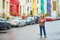 Girl in the Notting Hill district of London, UK