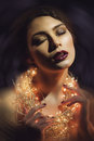 Girl with ny garland beautiful woman bright makeup holding alight wrapped around her neck Stock Images