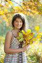 Girl with oak leaves posy Stock Photography
