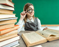 Girl open-eyed with magnifier Royalty Free Stock Photo