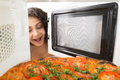 Girl open a microwave attractive Royalty Free Stock Photo