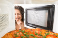 Girl open a microwave attractive Stock Photo