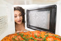 Girl open a microwave attractive Stock Photos