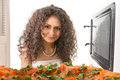 Girl open a microwave attractive Royalty Free Stock Photos