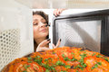 Girl open a microwave attractive Stock Images