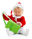 Girl opening a christmas gift little isolated over white background Royalty Free Stock Images