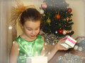 Girl opens a box with a gift Royalty Free Stock Photo