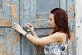 Girl opens a old door