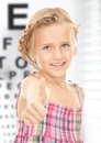 Girl with optical eye chart medicine and vision concept Stock Photo